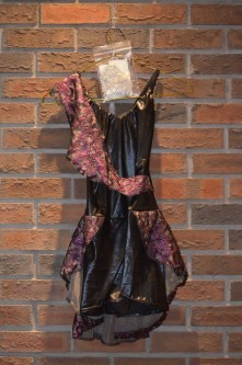 For Rent Item 001. Black leather material with pink accent; good for jazz or contemporary. Size: Intermediate/Senior