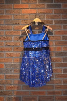 For Rent Item 011. Blue sparkly dress with black collar and black shorts. Tap; size: Intermediate