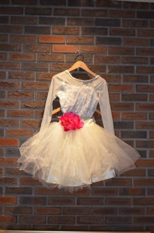 For Rent Item 013. Cream coloured leotard with lace and sheer sleeves, silver underlay; cream coloured tutu with pink flower and one without the flower; ballet/lyrical; size: intermediate. Two of these costumes.