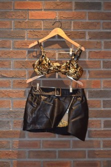 For Rent Item 014. Leather skirt with gold sparkly shorts underneath, half top (black or gold and black), jazz, size: senior.