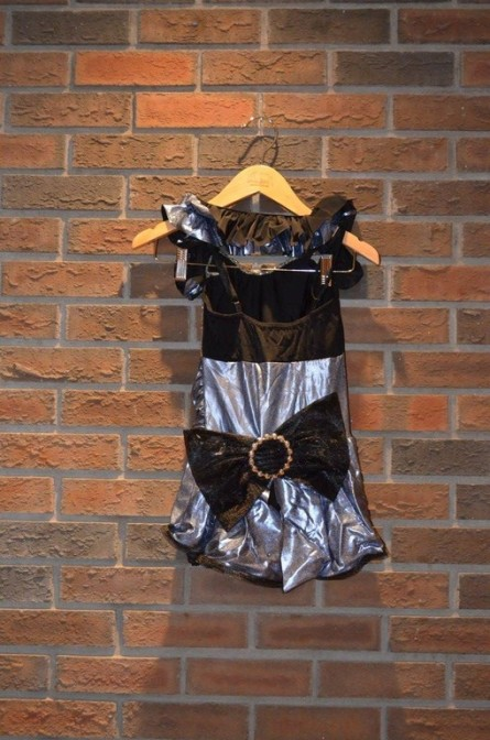For Rent Item 015. Silver, gold, and black jazz costume with a bow on the back, size: junior/intermediate.