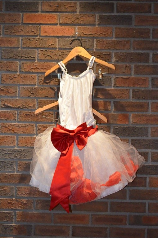 For Rent Item 017. White bodysuit with a white tutu (red bow and red petals in tutu); size: junior, ballet.