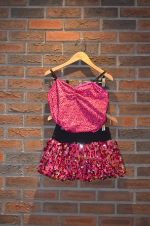 For Rent Item 020. Pink sequin top with black shorts and a pink and silver sparkly skirt, size: intermediate.