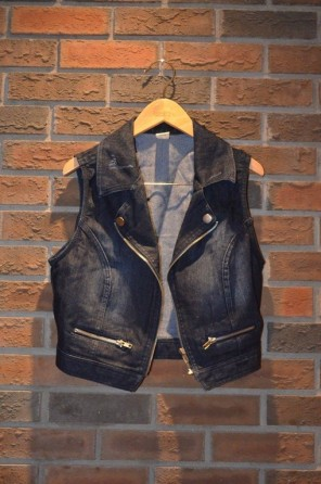 For Rent Item 021. Denim vest with silver zippers, sixe: Intermediate.