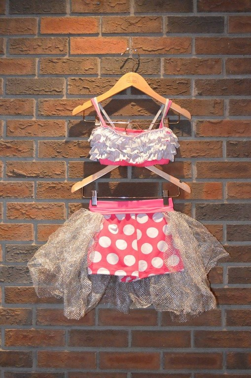 For Rent Item 022. Pink with white polka dot and silver ruffles half top and polka dot shorts with silver tulle accents on shorts, size: Junior/Intermediate, tap/jazz. There are three of these costumes.