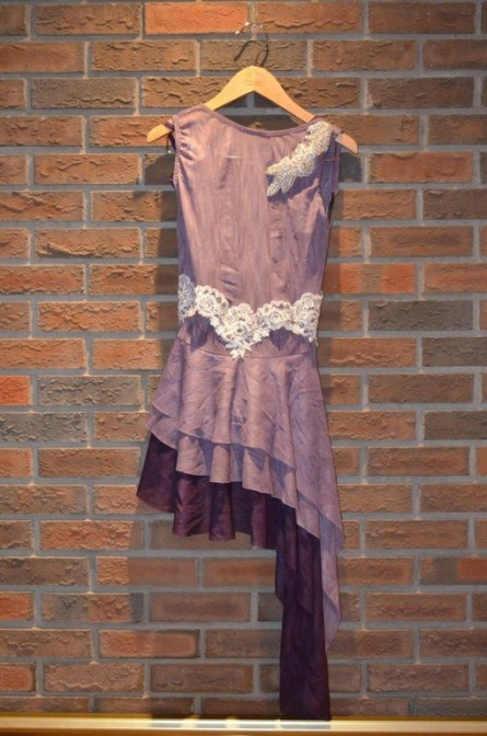 For Rent Item 026. Purple bodysuit with two tone purple dress; white, sparkly decorative accents; lyrical/ballet; size: Intermediate. There are three of these costumes