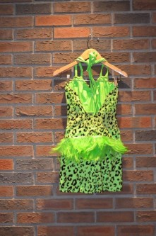 For Rent Item 028. Bright green leopard shorts outfit, sheer in the middle and green feathers as accent on the back, includes green wristlets; size: intermediate.