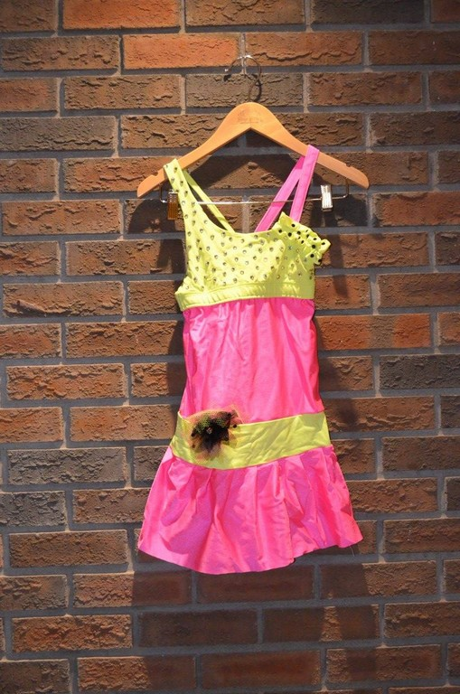 For Rent Item 038. Pink and yellow short set with feather accents; size: intermediate.
