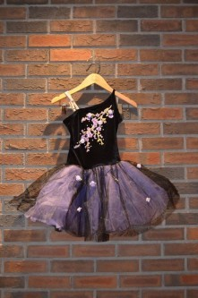 For Rent Item 049. Black and purple ballet costume with flower accents; size: junior/intermediate.