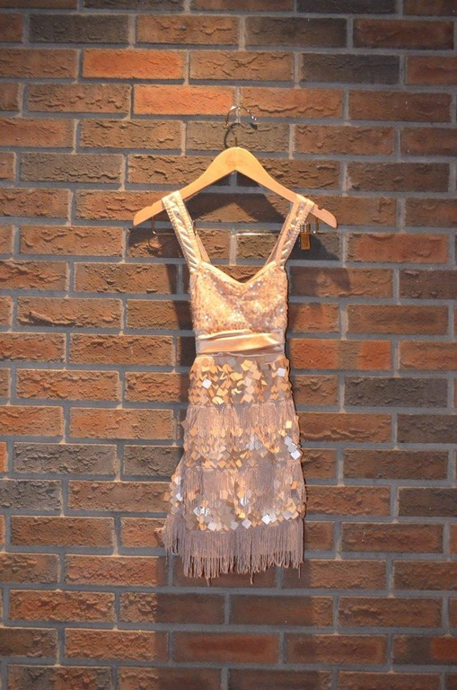 "For Rent Item 053. Gold/Bronze swinger's dress. ""20's"" era; size: Junior"