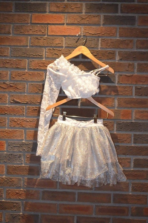 For Rent Item 057. White lace half top with one arm, silver tulle skirt; size: junior/intermediate.