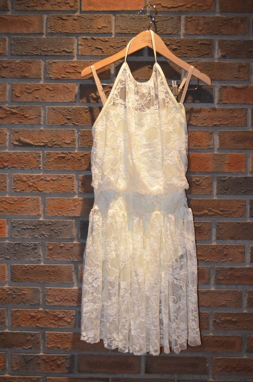 For Rent Item 061. Cream coloured halter dress with lace; size: intermediate.
