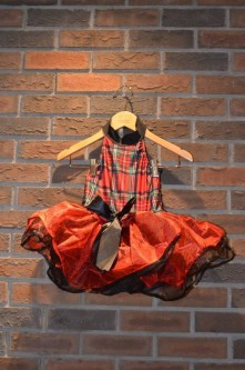 For Rent Item 063. Red plaid top with black collar, black bow on red tutu, black underlay and trim; size: junior