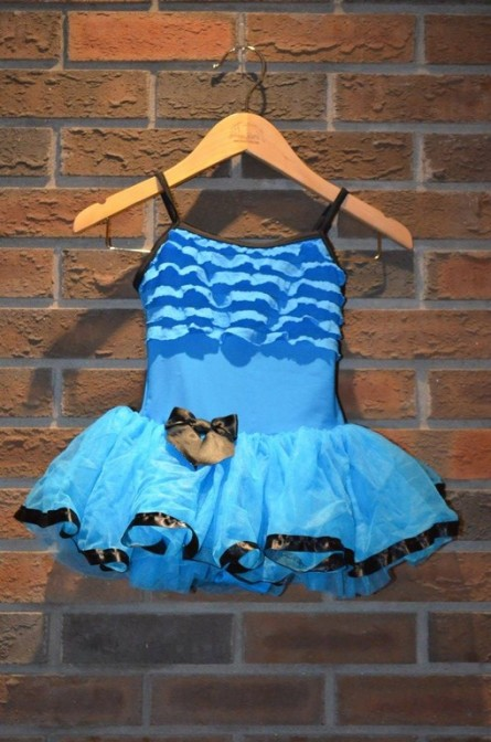 For Rent Item 064. Blue and black trim bodice (has ruffles) with tutu; ballet; size: junior.