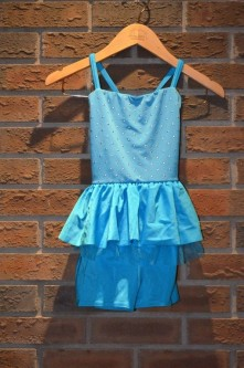 For Rent Item 065. Blue short set with skirt accent, buttons on top, silver accents; size: junior/intermediate