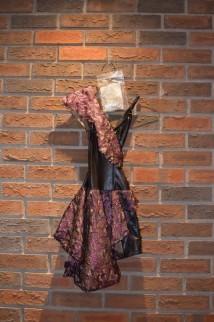For Rent Item 068. Black and purple dress, size intermediate.
