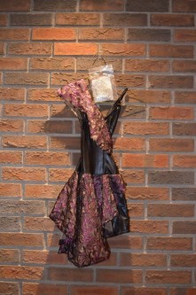 For Rent Item 068. Black and purple dress, size intermediate.
